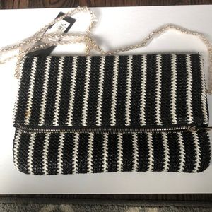 Street level Black and white clutch bag with strap
